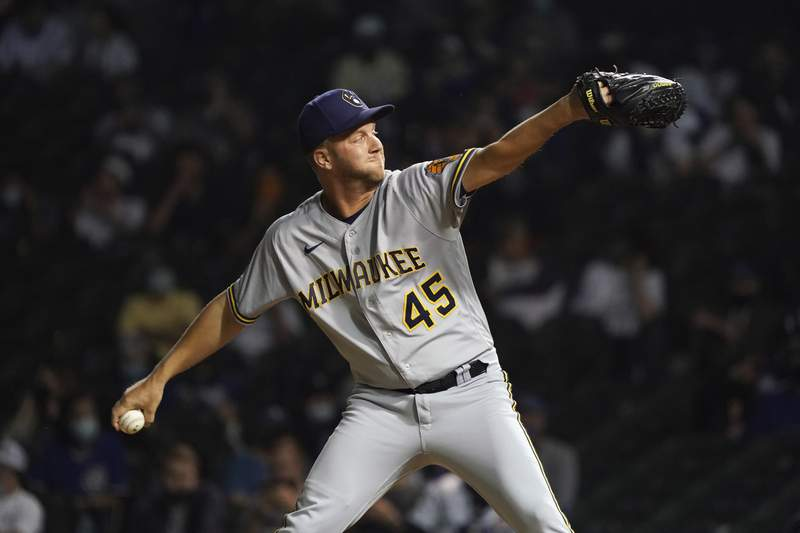 Milwaukee Brewers relief pitcher Brad Boxberger throws against the Chicago Cubs during the ninth inning of a baseball game, Tuesday, April 6, 2021, in Chicago. (AP Photo/David Banks)