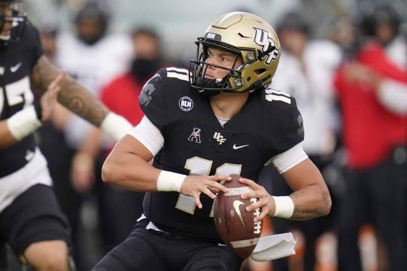 Central Florida quarterback Dillon Gabriel looks for a receiver during the first half of an NCAA college football game against Cincinnati, Saturday, Nov. 21, 2020, in Orlando, Fla. (AP Photo/John Raoux)