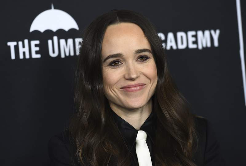 """FILE - Elliot Page arrives at the Los Angeles premiere of """"The Umbrella Academy"""" on Feb. 12, 2019. Page, the Oscar-nominated actor of Juno, Inception and The Umbrella Academy came out as transgender on Tuesday in an announcement greeted as a watershed moment for the trans community in Hollywood. The 33-year-old actor from Nova Scotia said his decision came after a long journey and with much support from the LGBTQ community. (Photo by Jordan Strauss/Invision/AP, File)"""