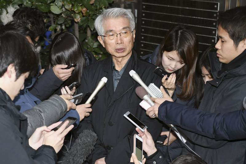 Junichiro Hironaka, center, lawyer for Nissan's former chairman Carlos Ghosn, speaks to the media in Tokyo following a meeting with colleagues Saturday, Jan. 4, 2020. Ghosn, who was awaiting trial in Japan on financial misconduct charges, was last seen on surveillance video leaving his Tokyo home alone on Dec. 29, presumably to board his getaway plane. (Kyodo News via AP)