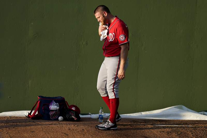 Washington Nationals starting pitcher Stephen Strasburg warms up in the bullpen before a spring training baseball game against the Houston Astros, Tuesday, March 9, 2021, in West Palm Beach, Fla. (AP Photo/Lynne Sladky)