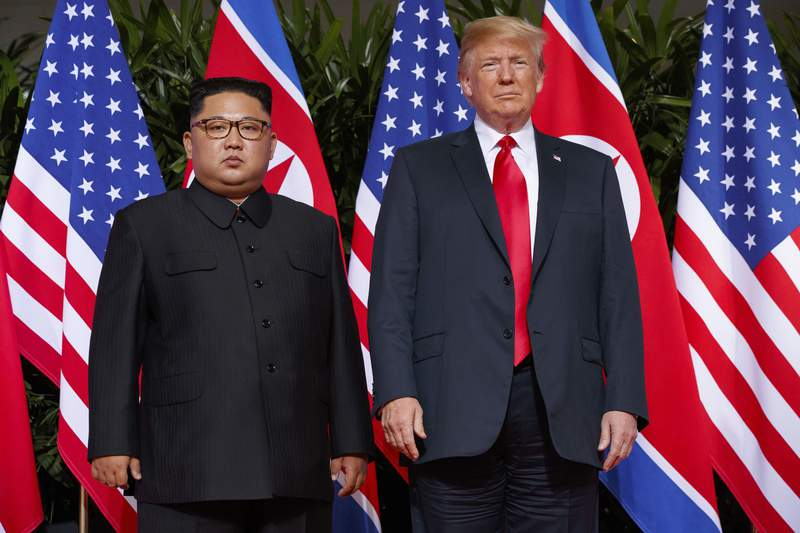 """FILE - In this June 12, 2018, file photo, U.S. President Donald Trump, right, meets with North Korean leader Kim Jong Un on Sentosa Island, in Singapore. North Korea on Saturday, July 4, 2020, reiterated it has no immediate plans to resume nuclear negotiations with the United States unless Washington discards what it describes as """"hostile"""" polices toward Pyongyang. (AP Photo/Evan Vucci, File)"""