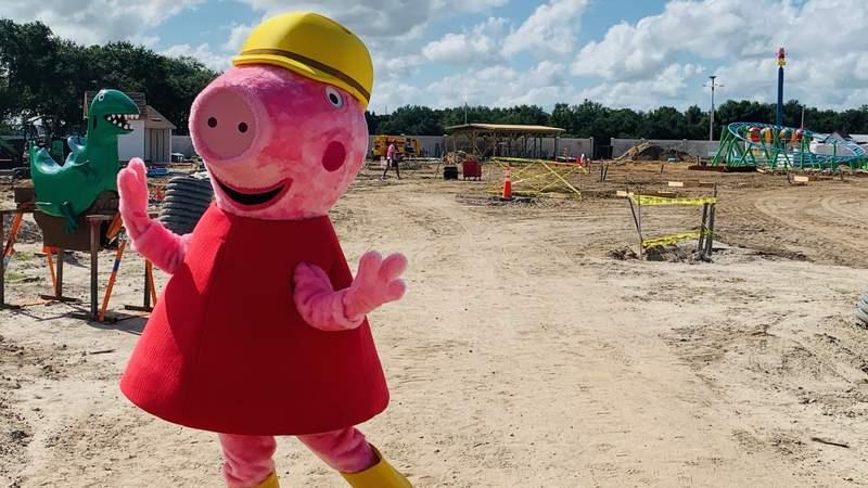 Peppa Pig posing at new theme park