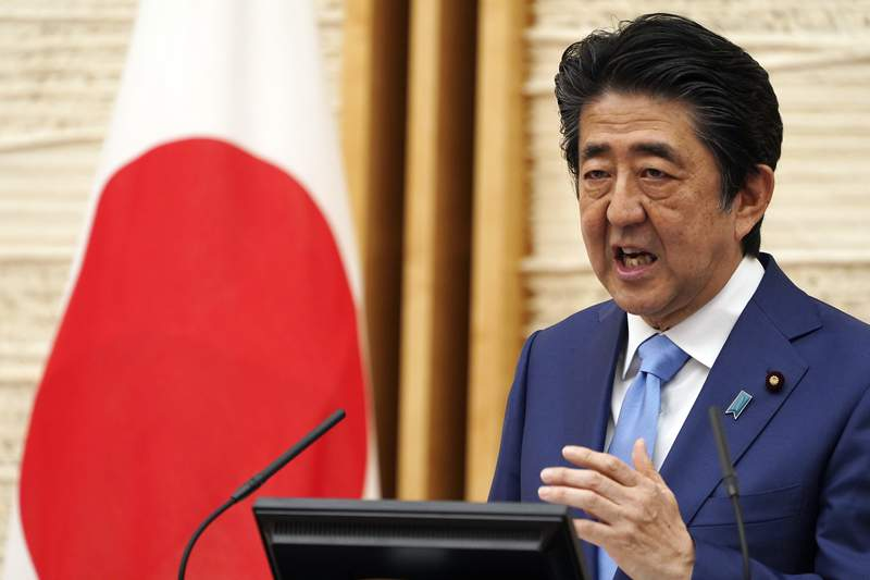 FILE - In this May 4, 2020, file photo, Japan's Prime Minister Shinzo Abe speaks during a press conference at his official residence in Tokyo. Japans NHK and other media say Friday, Aug. 28, 2020, Prime Minister Shinzo Abe has expressed his intention to step down, citing his health. (AP Photo/Eugene Hoshiko, Pool, File)