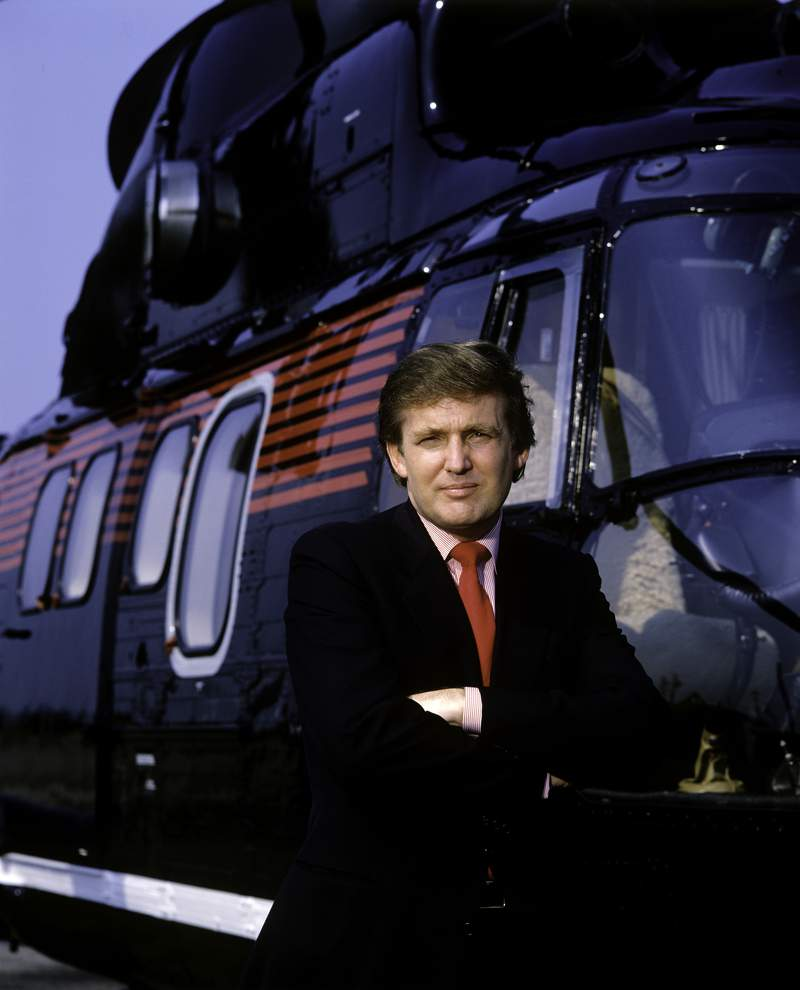 Donald Trump, real estate mogul, entrepreneur and billionaire, utilizes his personal helicopter to get around on Aug. 1987 in New York City.  (Photo by Joe McNally/Getty Images)