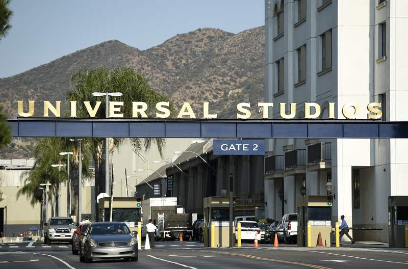 FILE - In this Aug. 23, 2016 file photo, the entrance to the Universal Studios lot is pictured in Universal City, Calif. A film built around the premise of liberal elites hunting people for sport in red states is coming to theaters in March, and the studio behind it is leaning into controversy about its premise. Universal Pictures on Tuesday, Feb. 11, 2020,  unveiled a trailer announcing The Hunt will be released March 13, roughly six months after it was supposed to have been released.   (Photo by Chris Pizzello/Invision/AP, File)
