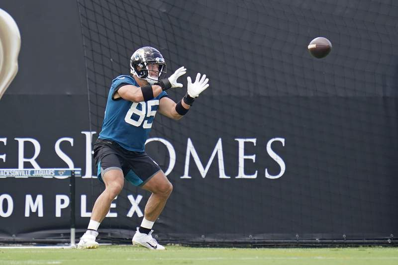 Jacksonville Jaguars tight end Tim Tebow catches a pass during an NFL football team practice, Tuesday, June 8, 2021, in Jacksonville, Fla. (AP Photo/John Raoux)