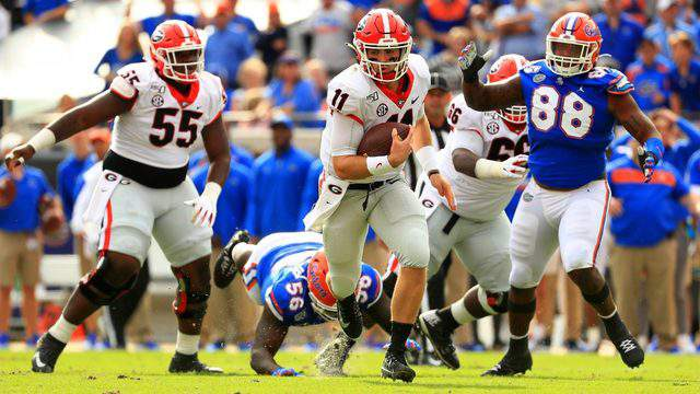 Georgia Bulldogs quarterback Jake Fromm rushes during a game against the Florida Gators on Nov. 2, 2019 in Jacksonville, Florida.