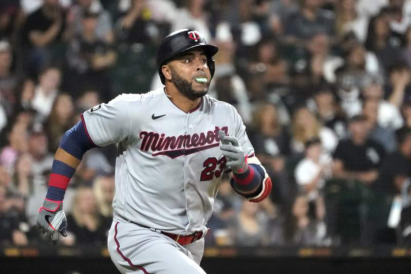 Minnesota Twins' Nelson Cruz watches his ground-rule double off Chicago White Sox starting pitcher Dylan Cease during the fifth inning of a baseball game Wednesday, July 21, 2021, in Chicago. (AP Photo/Charles Rex Arbogast)