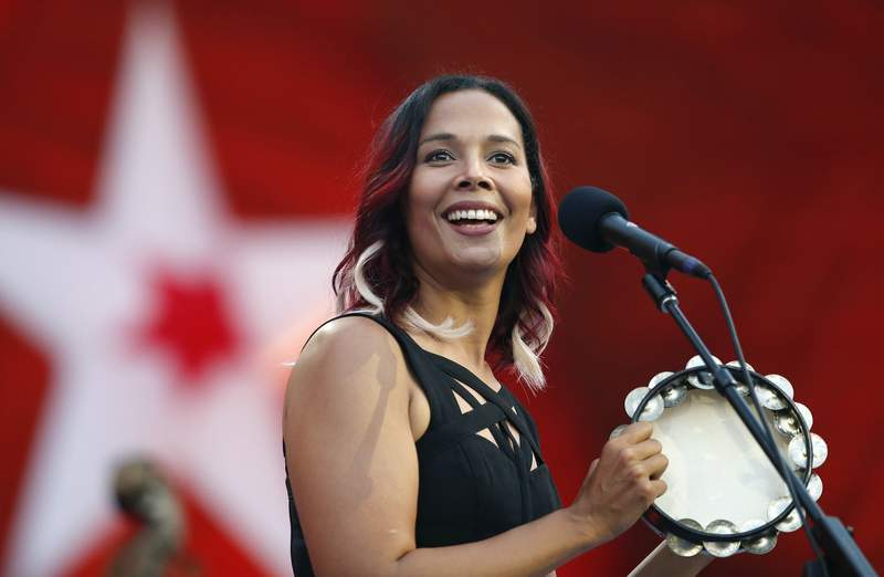 FILE - In this Tuesday, July 3, 2018, file photo, Rhiannon Giddens performs during rehearsal for the Boston Pops Fireworks Spectacular in Boston. The Grammy-winning musician is Silkroad's new artistic director, taking the baton from renowned cellist Yo-Yo Ma, who founded the group two decades ago, Silkroad said on Tuesday, July 28, 2020. The North Carolina native is the first woman and first multiracial artist to lead the Boston-based organization. (AP Photo/Michael Dwyer, File)