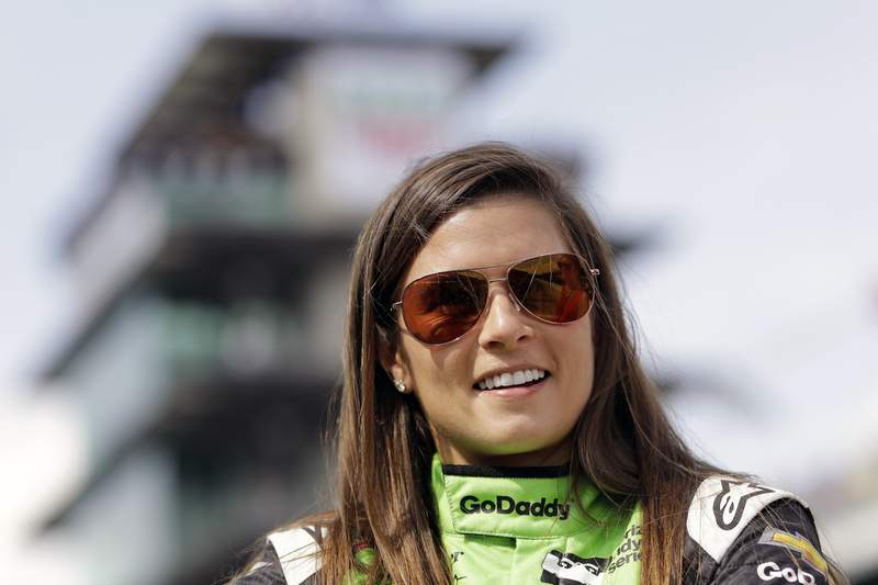 """FILE - In this May 20, 2018, file photo, Danica Patrick waits during qualifications for the IndyCar Indianapolis 500 auto race at Indianapolis Motor Speedway in Indianapolis. Danica Patrick will be on track at the Indianapolis 500, at the front of the field once again. Patrick was announced Wednesday, May 19, 2021, as pace car driver for the Indianapolis 500. She will drive a 2021 mid-engine Chevrolet Corvette Stingray hardtop convertible to lead the field to green at the start of the May 30 race.   I have always loved Chevy vehicles, and the Corvette convertible is such a beautiful car,"""" Patrick said. """"Maybe they will let me drive it home.(AP Photo/Darron Cummings, File)"""
