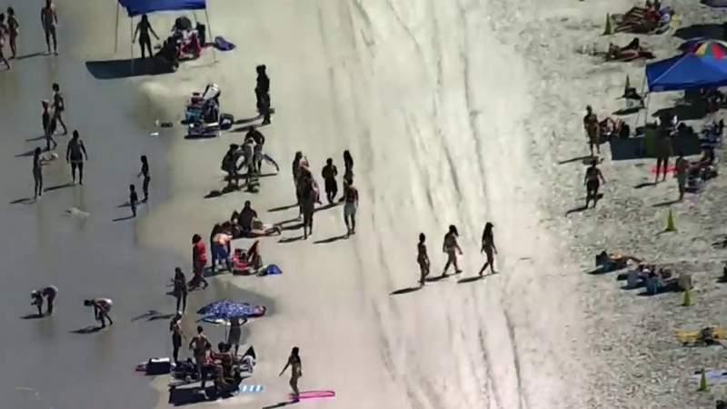 Police patrol Florida beaches to enforce new coronavirus rules
