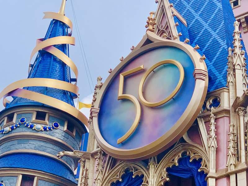 Disney installs 50th anniversary crest at Magic Kingdom