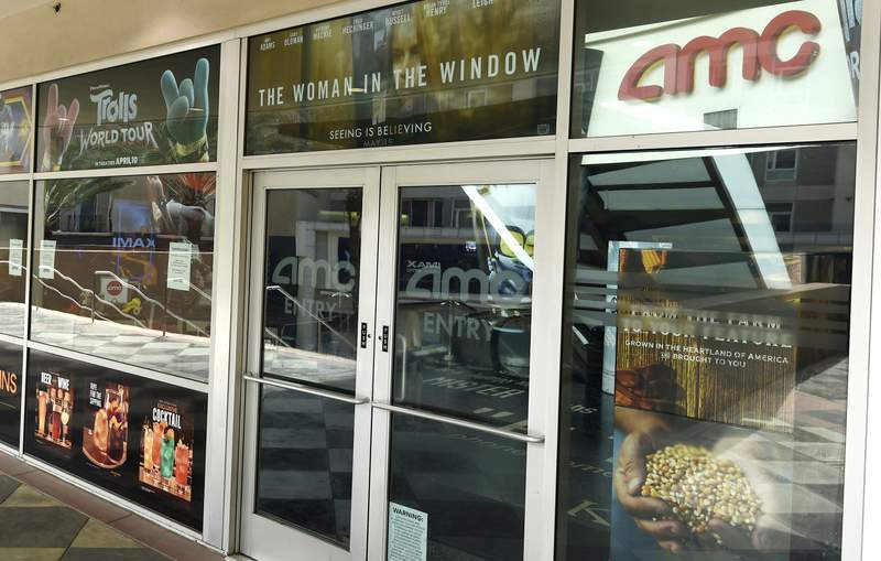 """FILE - The front entrance to the currently closed AMC Burbank 16 movie theaters complex is pictured on April 29, 2020, in Burbank, Calif. AMC Theatres and Universal Studios on Tuesday announced an agreement for a shortened theatrical window, with the studio's films playing for a minimum of just 17 days in cinemas. The agreement repaired a rift between AMC and Universal brought on by the on-demand release of """"Trolls World Tour"""" in April. (AP Photo/Chris Pizzello, File)"""
