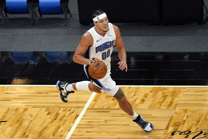 Orlando Magic forward Aaron Gordon moves the ball against the Cleveland Cavaliers during the second half of an NBA basketball game, Monday, Jan. 4, 2021, in Orlando, Fla. (AP Photo/John Raoux)