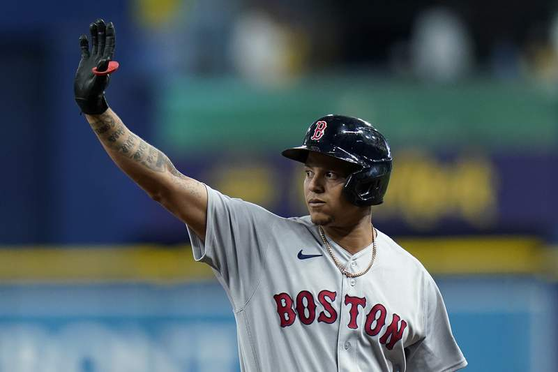 Boston Red Sox's Yairo Munoz celebrates after his single off Tampa Bay Rays relief pitcher J.P. Feyereisen during the seventh inning of a baseball game Monday, Aug. 30, 2021, in St. Petersburg, Fla. (AP Photo/Chris O'Meara)