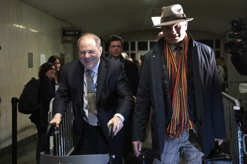 Harvey Weinstein, left, leaves court with attorney Arthur Aidala after attending his trial on charges of rape and sexual assault, Thursday, Jan. 30, 2020 in New York. (AP Photo/Mark Lennihan)