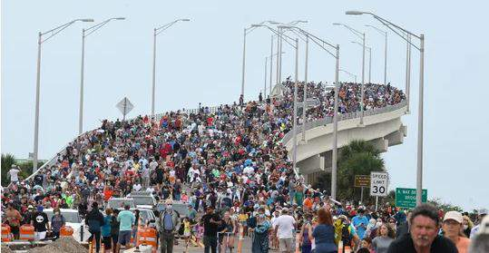 Huge crowds of SpaceX spectators who gathered on A. Max Brewer Bridge in Titusville, Fla., hoping to see the first U.S. crewed mission in almost a decade, start the walk back to their vehicles after the launch was scrubbed. (Photo: TIM SHORTT/FLORIDA TODAY)
