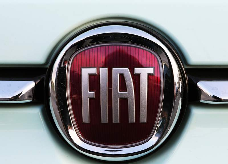 FILE - In this Oct. 31, 2019 file photo, a Fiat logo is pictured on a car in Bayonne, southwestern France. Fiat Chrysler Automobiles and PSA Peugeot announced Wednesday, Dec. 18, 2019, that their boards signed a binding deal to merge the two automakers, creating the worlds fourth-largest auto company. (AP Photo/Bob Edme, File)