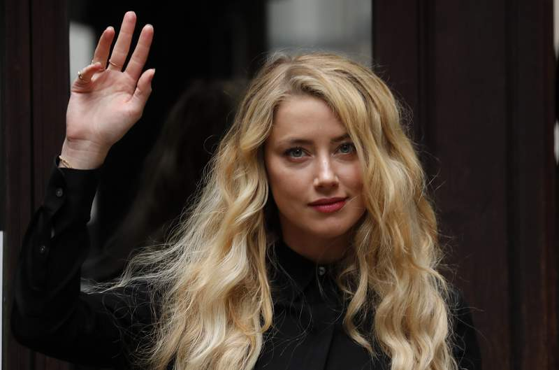 US Actress Amber Heard, former wife of actor Johnny Depp, arrives at the High Court in London, Tuesday, July 28, 2020. Hollywood actor Johnny Depp is suing News Group Newspapers over a story about his former wife Amber Heard, published in The Sun in 2018 which branded him a 'wife beater', a claim he denies.(AP Photo/Frank Augstein)