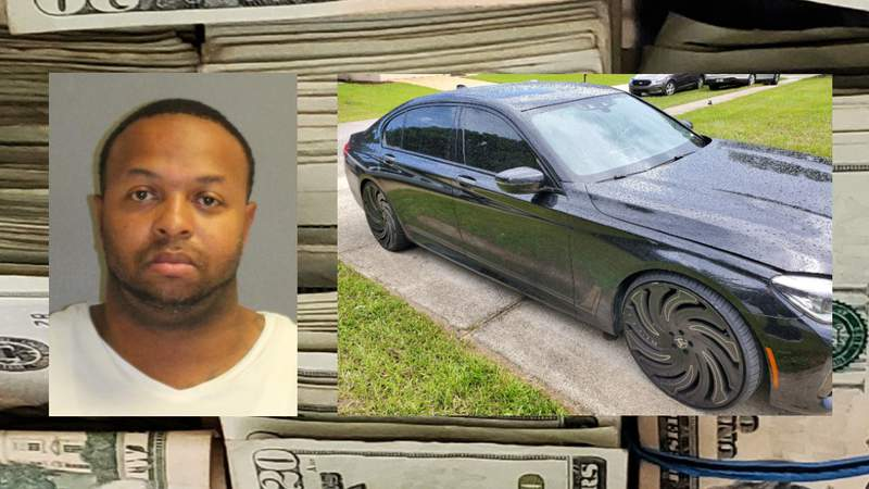 Arthur Wilcher pictured with a stolen BMW and a large amount of cash.