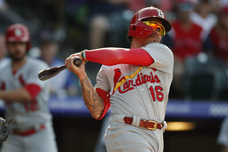 FILE - St. Louis Cardinals second baseman Kolten Wong (16) bats in the ninth inning of a baseball game against the Colorado Rockies in Denver, in this Thursday, Sept. 12, 2019, file photo. Kolten Wong has joined the Milwaukee Brewers as he changes teams for the first time after spending eight seasons with the St. Louis Cardinals. The Brewers announced Friday, Feb. .5, 2021, that they had signed Wong to a two-year contract with a club option for 2023.(AP Photo/David Zalubowski, File)