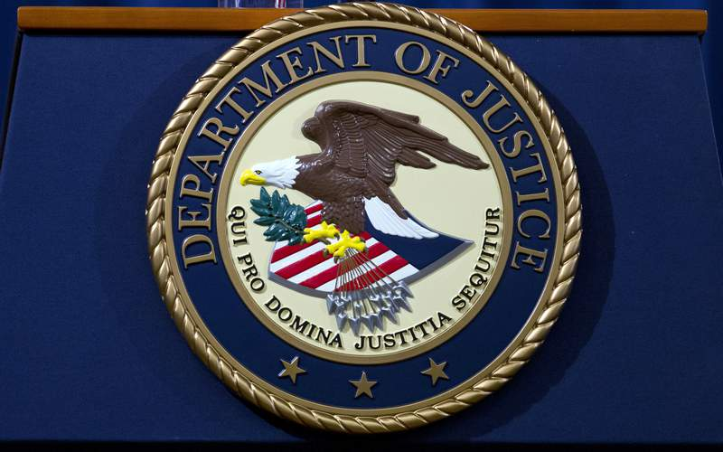 FILE - In this Nov. 28, 2018, file photo, the Department of Justice seal is seen in Washington, D.C. The Justice Department has released a new regulation spelling out detailed nationwide requirements for sex offender registration under a law Congress passed in 2006. The regulation released Monday stems from the Sex Offender Registration and Notification Act. It requires convicted sex offenders to register in the states in which they live, work or attend school.  (AP Photo/Jose Luis Magana, File)