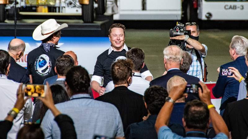 SpaceX founder and CEO Elon Musk celebrates inside the Kennedy Space Center Vehicle Assembly Building after his company successfully launched NASA astronauts Bob Behnken and Doug Hurley to orbit on May 30, 2020. (Image: Greg Scott)