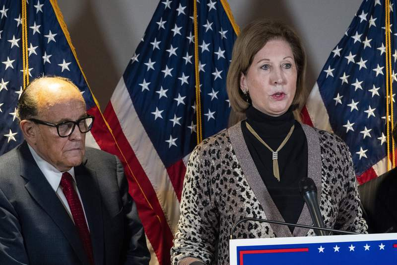 FILE -  Sidney Powell, right, speaks next to former Mayor of New York Rudy Giuliani, as members of President Donald Trump's legal team, during a news conference at the Republican National Committee headquarters on Nov. 19, 2020, in Washington. A federal judge cleared the way Wednesday, Aug. 11, 2021, for a defamation case by Dominion Voting Systems to proceed against Trump allies Powell, Rudy Giuliani and Mike Lindell, the founder and CEO of MyPillow, who had all falsely accused the company of rigging the 2020 presidential election. U.S. District Judge Carl Nichols handed down a ruling Wednesday that found there was no blanket protection on political speech. (AP Photo/Jacquelyn Martin, File)