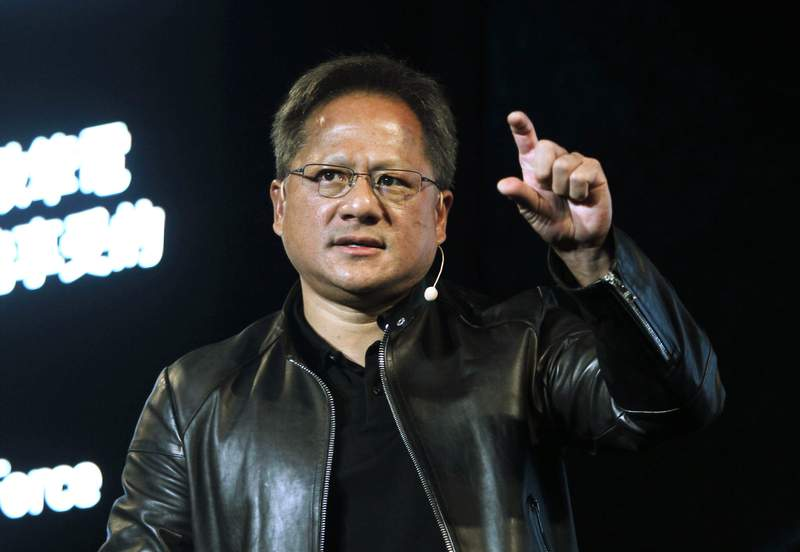 FILE - In this Tuesday, May 30, 2017 file photo, Nvidia CEO Jensen Huang delivers a speech about AI and gaming during the Computex Taipei exhibition at the world trade center in Taipei, Taiwan. Computer graphics chip company Nvidia said it plans to buy Britain's Arm Holdings for $40 billion, in a merger of two leading chipmakers. Santa Clara, California-based Nvidia and Arm's parent company, Japanese technology giant SoftBank, announced the deal Sunday, Sept. 13, 2020. (AP Photo/Chiang Ying-ying, File)