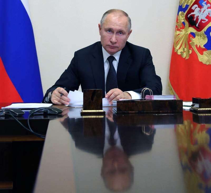 Russian President Vladimir Putin attends a meeting via video conference in Moscow, Russia, Wednesday, Dec. 23, 2020. (Mikhail Klimentyev, Sputnik, Kremlin Pool Photo via AP)