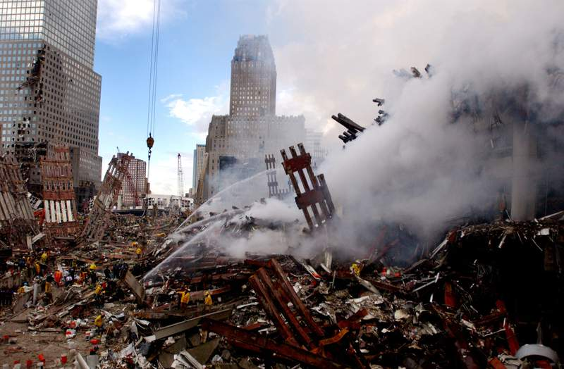 Fires still burn in the rubble of the World Trade Center, days after the terrorist attack.
