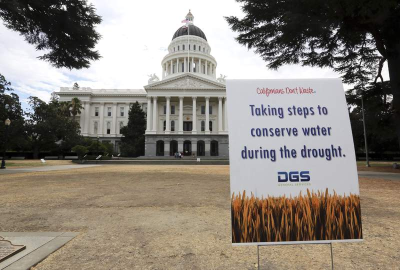 FILE - In this July 8, 2014, file photo, is a sign alerting visitors to water conservation efforts at the state Capitol in Sacramento, Calif. Gov. Gavin Newsom has declared an emergency executive order in two Northern California counties in response to drought conditions affecting much of the state. The announcement Wednesday, April 21, 2021, affects Mendocino and Sonoma counties, where Newsom says drought conditions are especially bad. (AP Photo/Rich Pedroncelli, File)