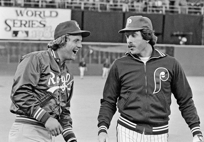 FILE - In this Oct. 14, 1980, file photo, Kansas City Royals slugger George Brett, left, and Philadelphia Phillies home run champ Mike Schmidt laugh during warmups before the first game of the World Series in Philadelphia. The money, the scouting, the buzz was all different when Major League Baseball held its annual June draft a half-century ago. With this year's picking set to start Wednesday, June 10, 2020, Schmidt remembers how it was when he was chosen in 1971. (AP Photo/File)