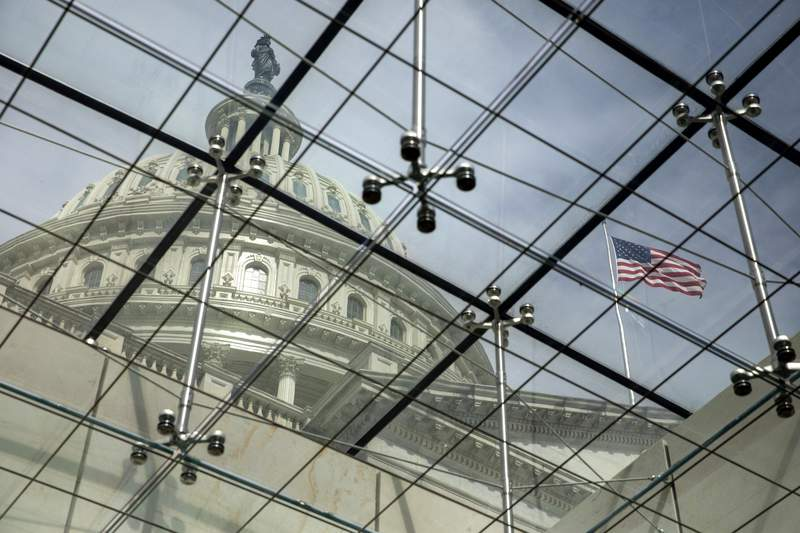 """FILE - In this April 29, 2021, file photo, the dome of the U.S. Capitol is seen through a glass ceiling in Washington. Momentum is building in Congress for taking sexual assault prosecution authority out of the hands of military commanders. That, combined with a softening of resistance by some military leaders, is pointing to an historic shift in the battle against what Defense Secretary Lloyd Austin calls """"the scourge of sexual assault."""" (AP Photo/Amanda Andrade-Rhoades, File)"""