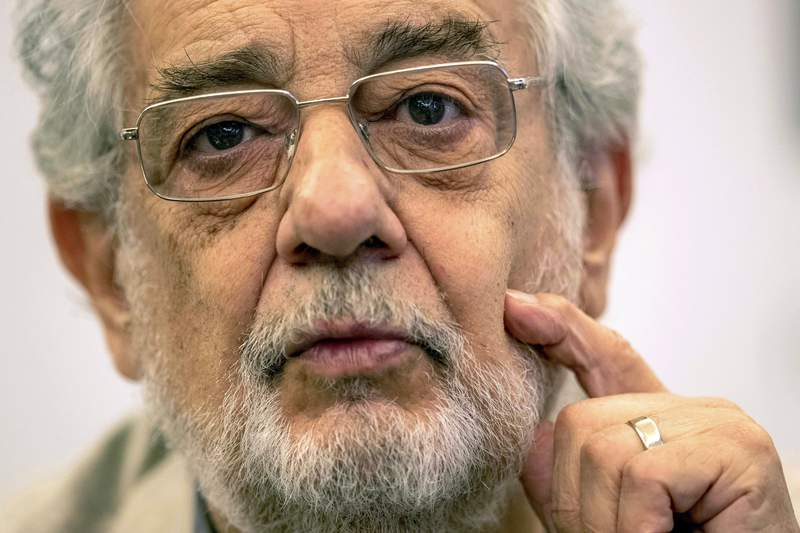 FILE - In this July 12, 2019 file photo, opera singer Placido Domingo speaks during a news conference about an upcoming show in Madrid, Spain. On Friday, March 20, 2020, the American Guild of Musical Artists said Domingo has resigned from the U.S. union that represents opera singers, after two investigations found sexual harassment allegations against him to be credible. The guild said he will also contribute $500,000 to sexual harassment eradication programs and a fund that helps opera employees in crisis. (AP Photo/Bernat Armangue, File)