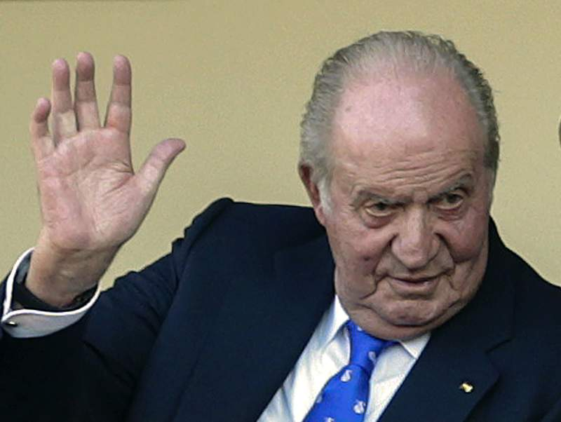 FILE - In this file photo dated Sunday, June 2, 2019, Spain's former King Juan Carlos waves at the bullring in Aranjuez, Spain.  The former lover of Spains King Emeritus Juan Carlos has filed a lawsuit with a British court accusing him of spying on her, the public relations firm representing Corinna Larsen confirmed Wednesday July 28, 2021. (AP Photo/Andrea Comas, FILE)