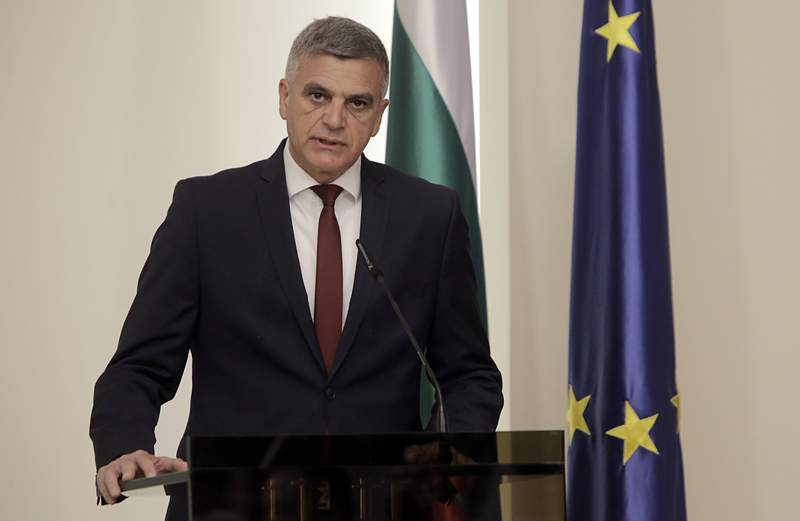 FILE - In this May 12, 2021 file photo, Bulgarian Interim PM Stefan Yanev attends a press conference in Sofia. Bulgarias interim prime minister called for a consolidation of national efforts to eradicate endemic graft. Yanev spoke at a meeting of the government security council he convened on Monday, June 7 to discuss new anti-corruption policies following the sanctions by the U.S. government on Bulgarian public officials and businessmen for their allegedly extensive roles in corruption. (AP Photo/Valentina Petrova, file)