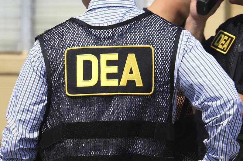 FILE - This June 13, 2016 file photo shows Drug Enforcement Administration (DEA) agents in Florida. On Friday, Feb. 21, 2020, the FBI arrested U.S. federal narcotics agent Jose Irizarry and his wife, Nathalia Gomez Irizarry, at their residence in Puerto Rico, according to a law enforcement official familiar with the arrest. He has been charged with conspiring to launder money with the very same Colombian drug cartels he was supposed to be fighting. (Joe Burbank/Orlando Sentinel via AP, File)