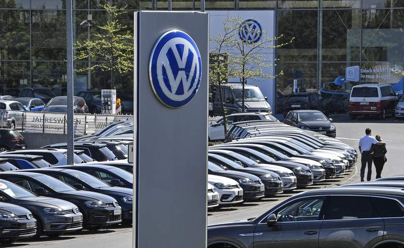 In this April 20, 2020 file photo, a Volkswagen car dealer is open in Essen, Germany. (AP Photo/Martin Meissner, File)