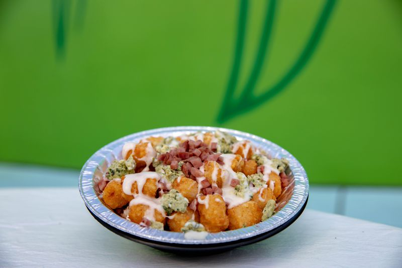 Universal Orlando Resort, includes green eggs, diced ham, white cheese sauce over tater tots