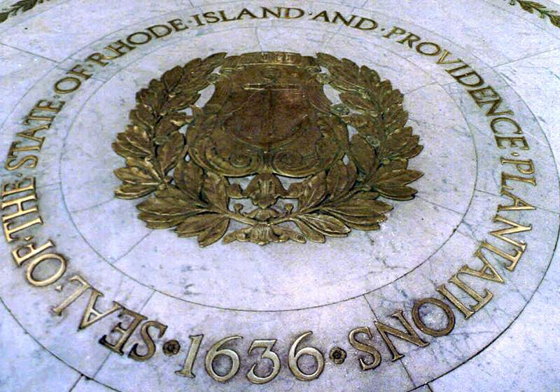 """FILE - This Jan. 21, 2000 file photo shows the seal of the State of Rhode Island and Providence Plantations on the floor of the Statehouse rotunda in Providence, R.I. On Thursday, July 16, 2020, state lawmakers approved placing a question on the November ballot to allow voters the option to remove """"and Providence Plantations"""" from the state's official name. (AP Photo/Susan E. Bouchard, File)"""