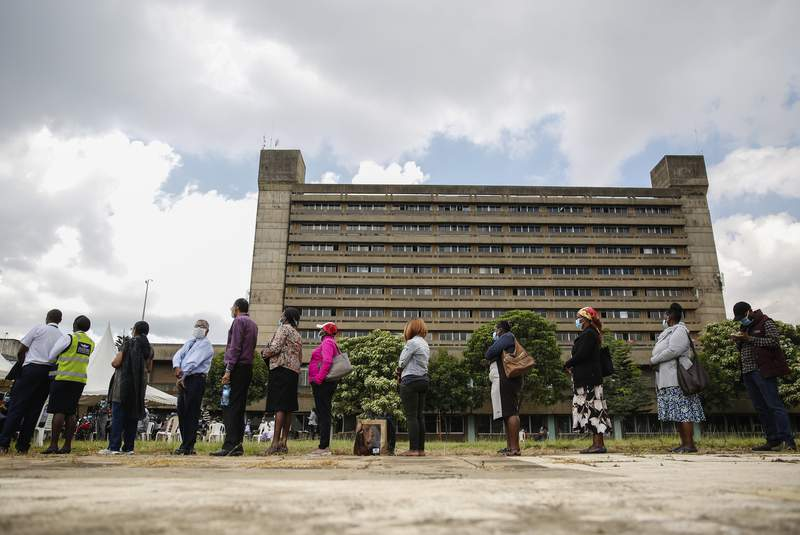 Kenyans line up to receive a dose of the AstraZeneca COVID-19 vaccine manufactured by the Serum Institute of India and provided through the global COVAX initiative, at Kenyatta National Hospital in Nairobi, Tuesday, April 6, 2021. (AP Photo/Brian Ingasnga)