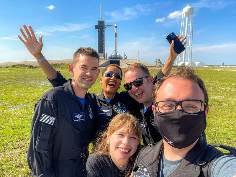 Photographer John Kraus (front) with the Inspiration 4 crew: Shift4 CEO Jared Isaacman (far left), Dr. Sian Proctor (back), Hayley Arceneaux, (bottom middle) and Chris Sembroski.