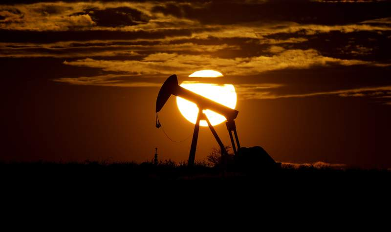 FILE - In this Wednesday, April 8, 2020, file photo, the sun sets behind an idle pump jack near Karnes City, Texas. Demand for oil continues to fall due to the new coronavirus outbreak. As demand for fuel plummeted worldwide and the oil industry faced a devastating drop in oil prices, the U.S. took the rare move of stepping into negotiations involving the member countries of OPEC and non-members such as Russia and Mexico. (AP Photo/Eric Gay, File)