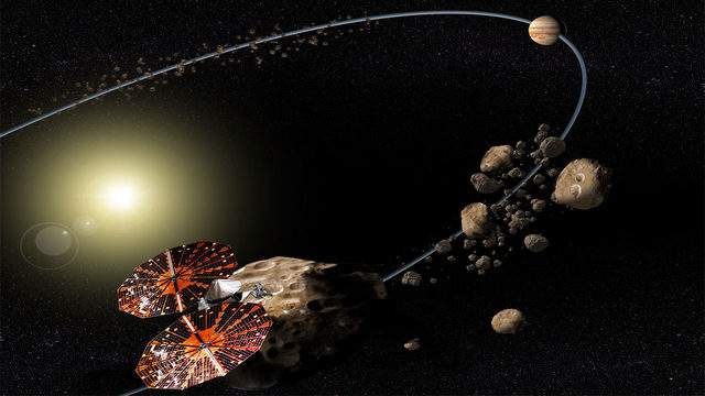 A rendering of the Lucy spacecraft and Jupiter's Trojan asteroids. The mission is slated to launch from Cape Canaveral in 2021. (Image credit: NASA)