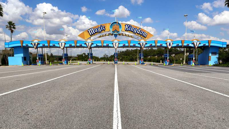 All is quiet at the parking plaza entrance to the Magic Kingdom as Walt Disney World enters its second week of being shut down in response to the coronavirus pandemic,Tuesday, March 24, 2020. (Joe Burbank/Orlando Sentinel via AP)