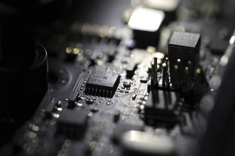 FILE - This Feb 23, 2019, file photo shows the inside of a computer. Three former U.S. intelligence and military operatives have agreed to pay nearly $1.7 million to resolve criminal charges that they provided sophisticated hacking technology to the United Arab Emirates. A charging document in federal court in Washington accuses them of helping develop advanced covert hacking systems for U.A.E. government agencies. (AP Photo/Jenny Kane, File)