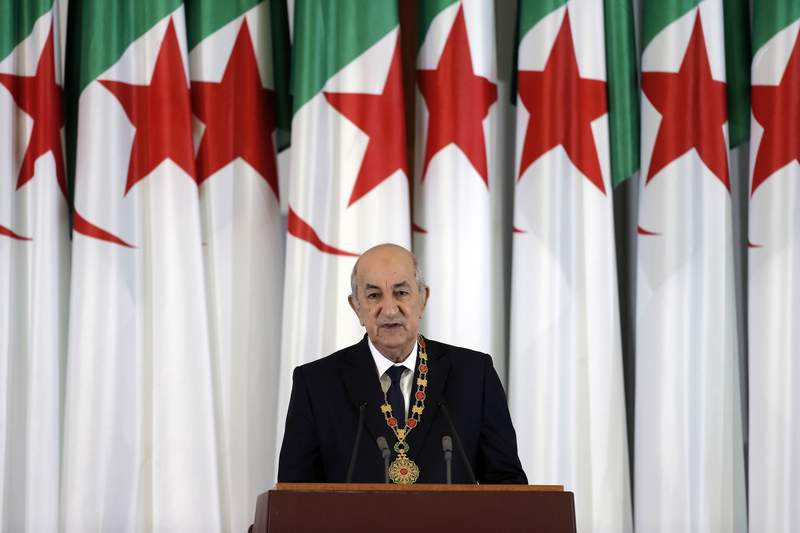 FILE - In this Thursday, Dec. 19, 2019 file photo, Algerian president Abdelmadjid Tebboune delivers a speech during an inauguration ceremony in the presidential palace, in Algiers, Algeria. Still recovering from COVID-19, Algeria's president suddenly reappeared Sunday Dec. 13, 2020, after nearly two months out of the public eye, saying in a video message that it may still be several more weeks before he is fit enough to return to his North African country. (AP Photo/Toufik Doudou, File)