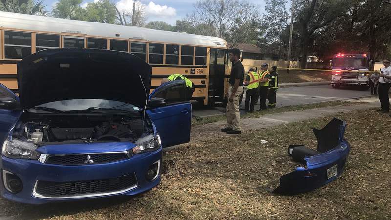 Three people in a car were injured after a crash involving a bus in DeLand.